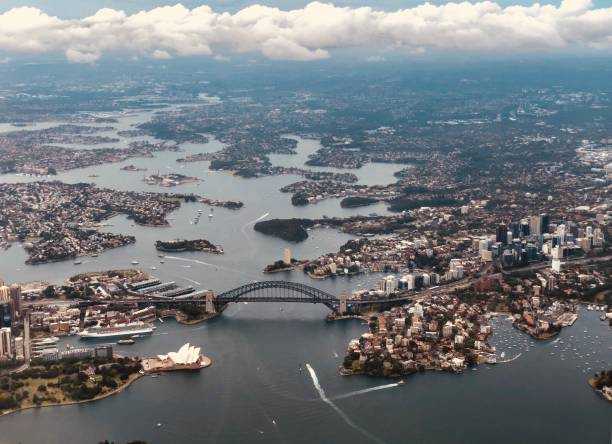 aerial view sydney with sydney harbour bridge - urban sprawl stock photos and pictures