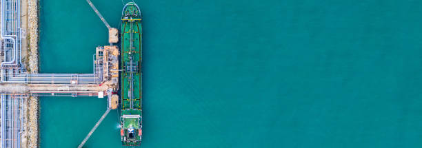Aerial view tanker ship at the port, Import export business logistic and transportation by tanker ship with copy space. stock photo