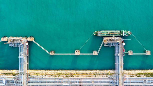 Aerial view tanker ship unloading at port, Business import export oil with tanker ship transportation oil from refinery on the sea. stock photo