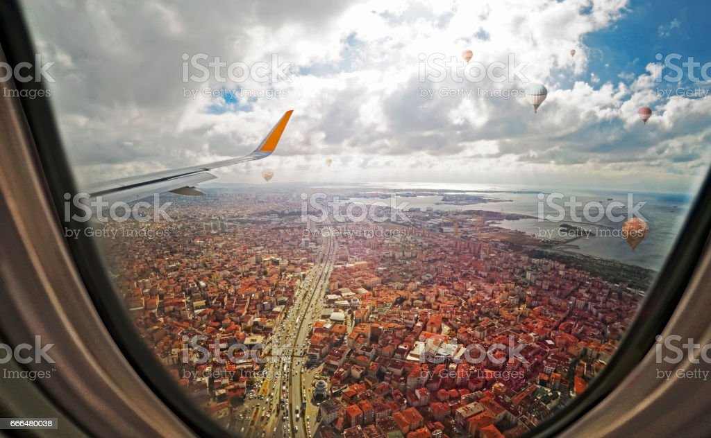 Aerial view through porthole of aircraft stock photo
