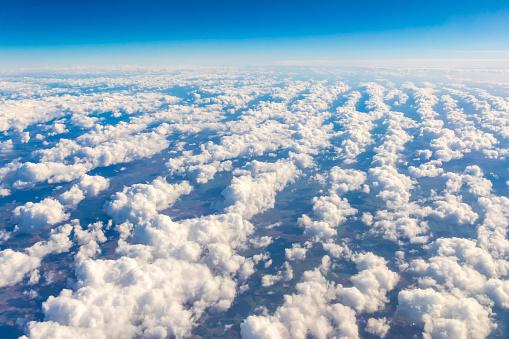 621114928 istock photo Aerial view through the airplane window 1132873063