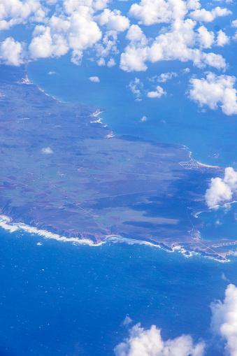 621114928 istock photo Aerial view through the airplane window 1203078646