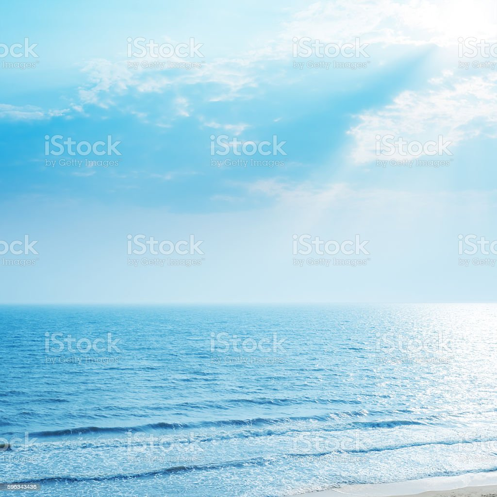 aerial view to sea and sunrays in blue sky royalty-free stock photo