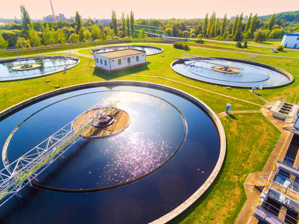 Aerial view to sewage treatment plant. Grey water recycling. Waste management in European Union. Aerial view to sewage treatment plant. Grey water recycling. Waste management in European Union. sewage stock pictures, royalty-free photos & images