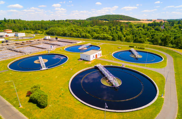 Aerial view to sewage treatment plant. Grey water recycling. Waste management in European Union. stock photo