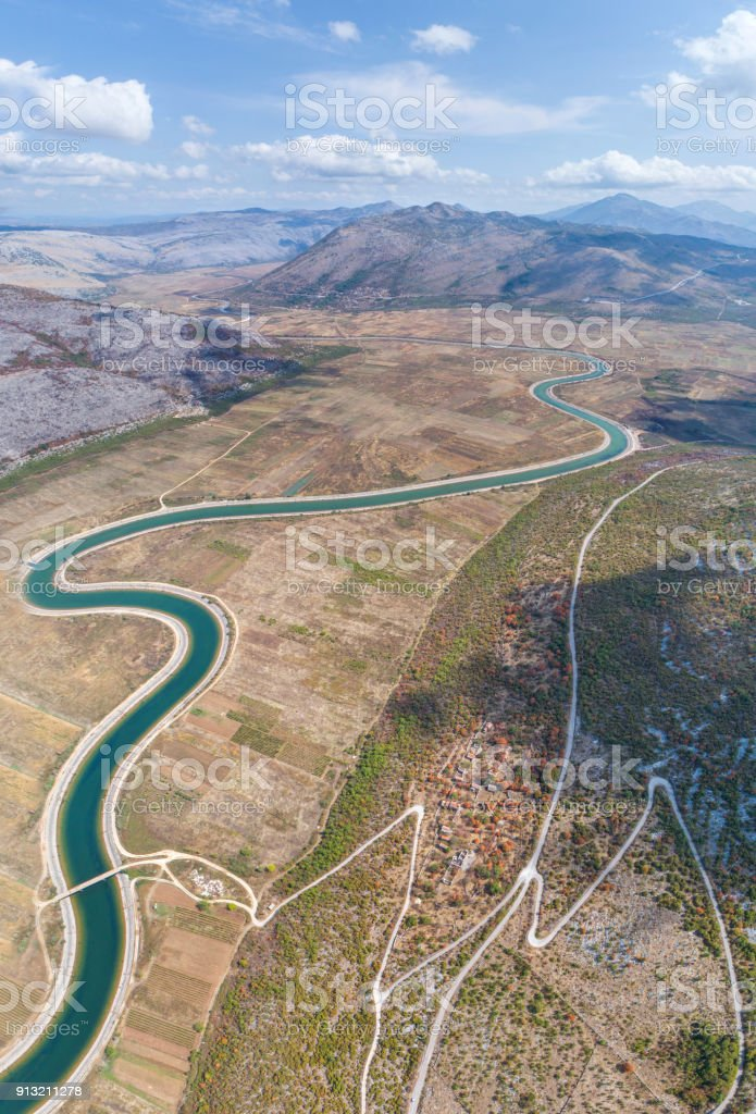 Aerial view to the valley and the Trebishnica river in the Bosnia and Hercegovina mountains. stock photo