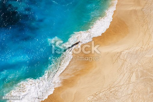 istock Aerial view to tropical sandy beach and blue ocean 874514476