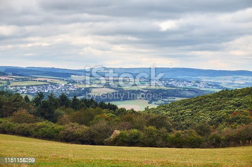istock Aerial view to villages hills and agriculture fields of Rheinland-Pfalz state with river Rhein from tourist route on Hesse land 1151156259
