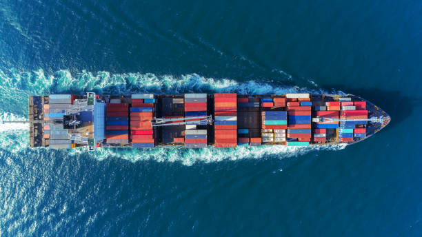 aerial view top speed with beautiful wave of container ship full load container with crane loading container for logistics import  export or transportation concept background. - logistica foto e immagini stock