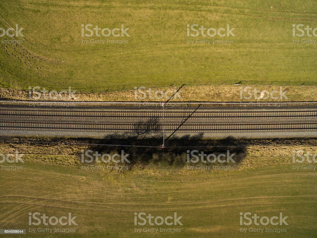 aerial view - top view of railroad tracks  in the countryside stock photo