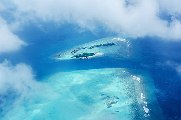 Aerial view tropical island resorts of maldives stock photo
