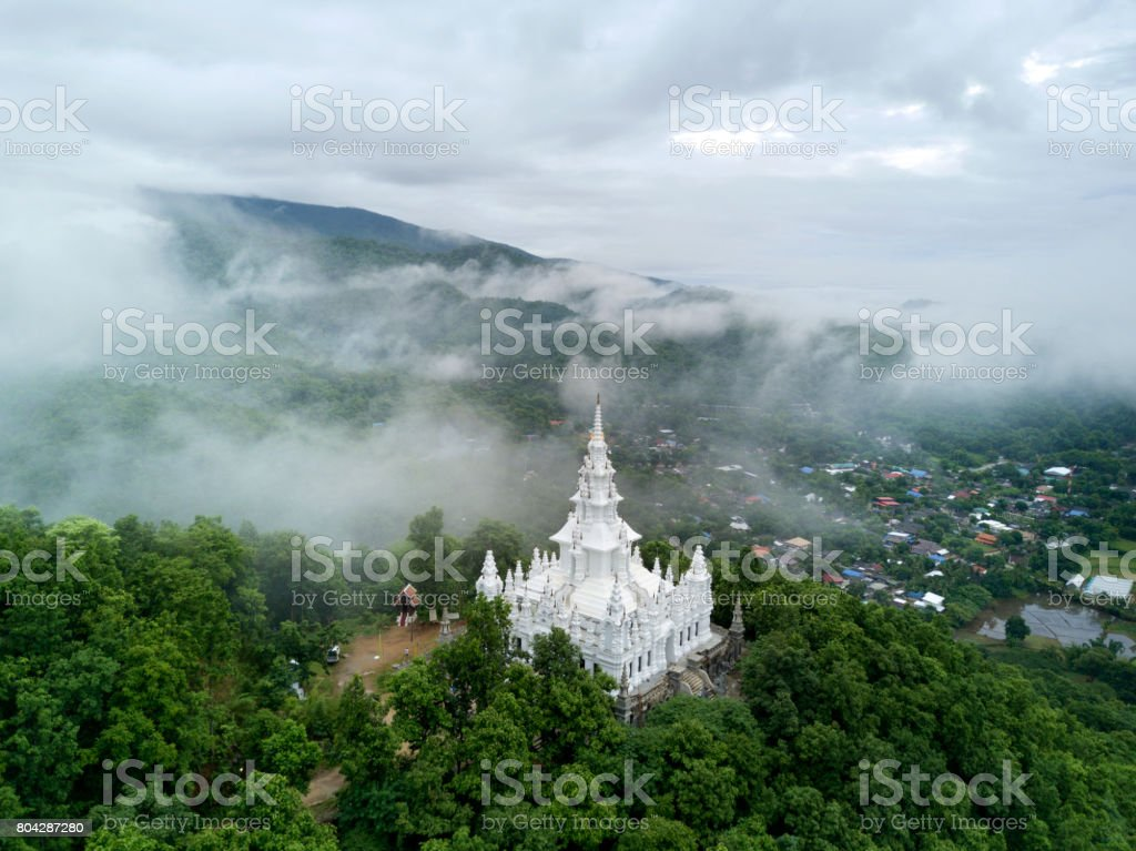 Aerial view, Wat Phra That Ban Pong and the foggy morning in Chiang mai, Thailand. stock photo