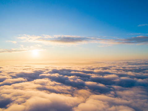 istock Aerial view White clouds in blue sky. Top view. View from drone. Aerial bird's eye view. Aerial top view cloudscape. Texture of clouds. View from above. Sunrise or sunset over clouds 1126749890