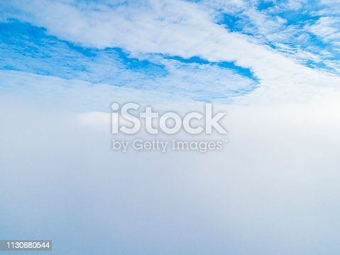 istock Aerial view White clouds in blue sky. Top view. View from drone. Aerial bird's eye view. Aerial top view cloudscape. Texture of clouds. View from above. Sunrise or sunset over clouds 1130680544