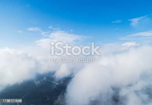 istock Aerial view White clouds in blue sky. Top view. View from drone. Aerial bird's eye view. Aerial top view cloudscape. Texture of clouds. View from above. 1136121549