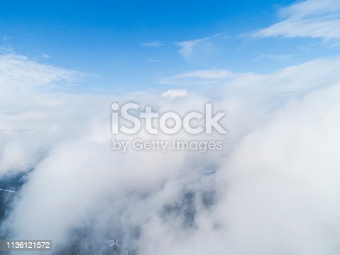 istock Aerial view White clouds in blue sky. Top view. View from drone. Aerial bird's eye view. Aerial top view cloudscape. Texture of clouds. View from above. 1136121572