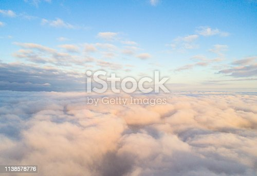 istock Aerial view White clouds in blue sky. Top view. View from drone. Aerial bird's eye view. Aerial top view cloudscape. Texture of clouds. View from above. Sunrise or sunset over clouds 1138578776