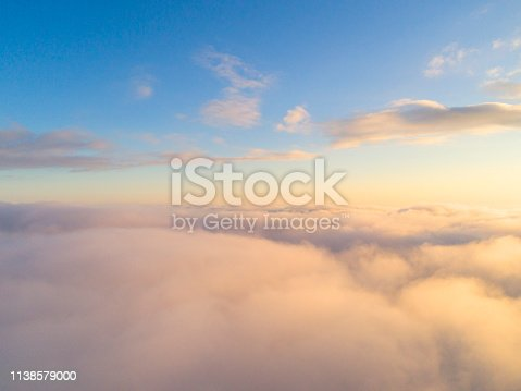 621591180 istock photo Aerial view White clouds in blue sky. Top view. View from drone. Aerial bird's eye view. Aerial top view cloudscape. Texture of clouds. View from above. Sunrise or sunset over clouds 1138579000