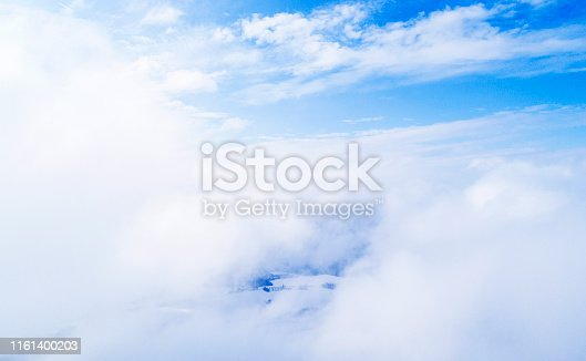 istock Aerial view White clouds in blue sky. Top view. View from drone. Aerial bird's eye view. Aerial top view cloudscape. Texture of clouds. View from above. 1161400203