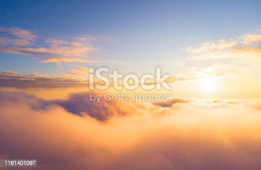 621591180 istock photo Aerial view White clouds in blue sky. Top view. View from drone. Aerial bird's eye view. Aerial top view cloudscape. Texture of clouds. View from above. Sunrise or sunset over clouds 1161401097