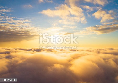 621591180 istock photo Aerial view White clouds in blue sky. Top view. View from drone. Aerial bird's eye view. Aerial top view cloudscape. Texture of clouds. View from above. Sunrise or sunset over clouds 1161401168