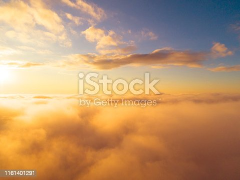 istock Aerial view White clouds in blue sky. Top view. View from drone. Aerial bird's eye view. Aerial top view cloudscape. Texture of clouds. View from above. Sunrise or sunset over clouds 1161401291