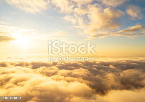 621591180 istock photo Aerial view White clouds in blue sky. Top view. View from drone. Aerial bird's eye view. Aerial top view cloudscape. Texture of clouds. View from above. Sunrise or sunset over clouds 1161401310