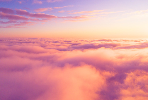 istock Aerial view White clouds in blue sky. Top view. View from drone. Aerial bird's eye view. Aerial top view cloudscape. Texture of clouds. View from above. Sunrise or sunset over clouds 1161401350