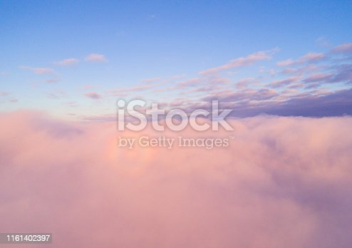 istock Aerial view White clouds in blue sky. Top view. View from drone. Aerial bird's eye view. Aerial top view cloudscape. Texture of clouds. View from above. Sunrise or sunset over clouds 1161402397