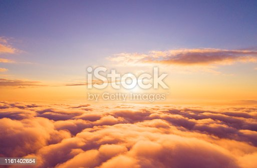 621591180 istock photo Aerial view White clouds in blue sky. Top view. View from drone. Aerial bird's eye view. Aerial top view cloudscape. Texture of clouds. View from above. Sunrise or sunset over clouds 1161402654