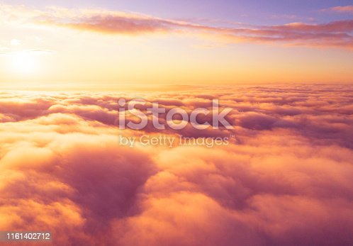 istock Aerial view White clouds in blue sky. Top view. View from drone. Aerial bird's eye view. Aerial top view cloudscape. Texture of clouds. View from above. Sunrise or sunset over clouds 1161402712