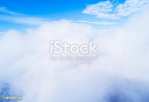 istock Aerial view White clouds in blue sky. Top view. View from drone. Aerial bird's eye view. Aerial top view cloudscape. Texture of clouds. View from above. 1161402714