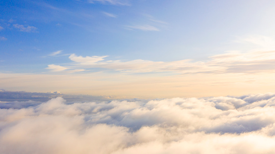 istock Aerial view White clouds in blue sky. Top view. View from drone. Aerial bird's eye view. Aerial top view cloudscape. Texture of clouds. View from above. Sunrise or sunset over clouds 1173065859