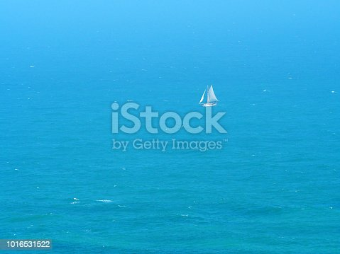 1066331604istockphoto Aerial view. White sailboat against the blue sea. Yacht with white sails 1016531522