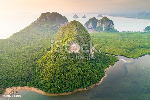 Aerial view wide shot beautiful sunset tropical beach sea in south thailand Asia