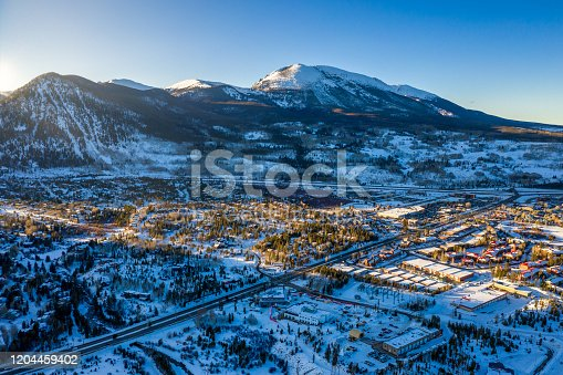 Aerial view winter wonderland sunset in Frisco Colorado