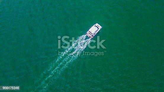 istock Aerial view, Yacht sailing in the ocean 956475346