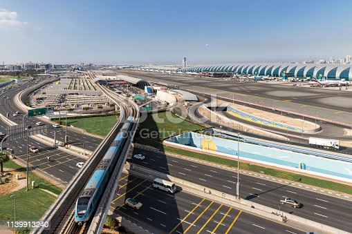 istock Aerial View.Airport Terminal with Airplanes Taxiing and Landing.In Dubai International Airport 1139913240