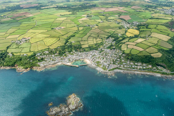 aerial views across the sea to mousehole, cornwall on a sunny june day. - cornwall stock pictures, royalty-free photos & images