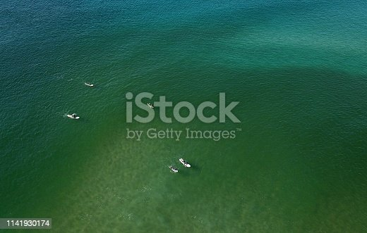 Aerial views of stand up paddle boards.
