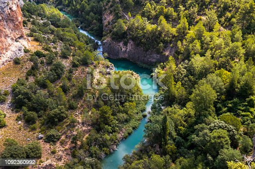 Aerial views of the meander of the river Jucar in Cuenca, Spain. Top view of the beautiful nature of the valley on a sunny day. Drone scene.