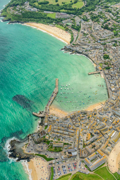 aerial views over st. ives, cornwall, england on a bright june day. - cornwall stock pictures, royalty-free photos & images