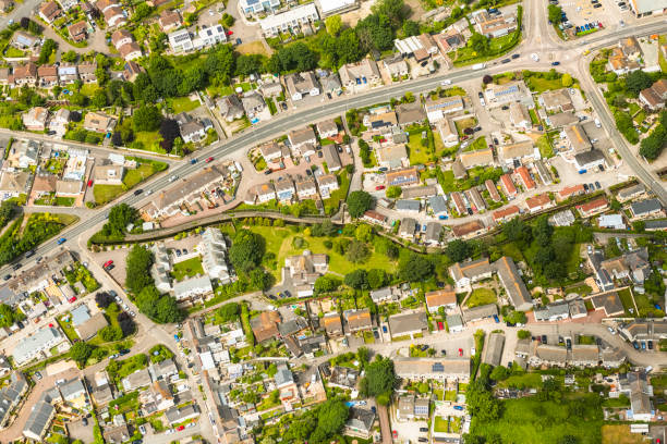 aerial views over suburban houses, hayle, cornwall on a sunny june day. - cornwall stock photos and pictures