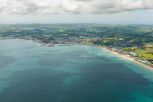 aerial views over the sea to penzance, newlyn and mousehole, cornwall on a bright sunny june day. - cornwall stock photos and pictures