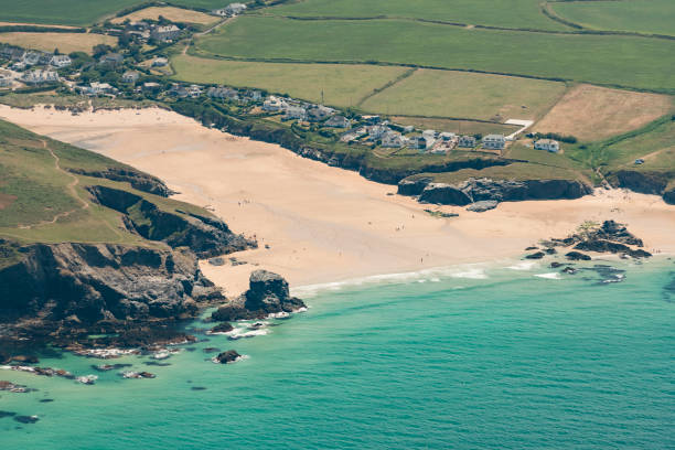 aerial views over treyarnon bay beach, north cornwall - cornwall stock photos and pictures