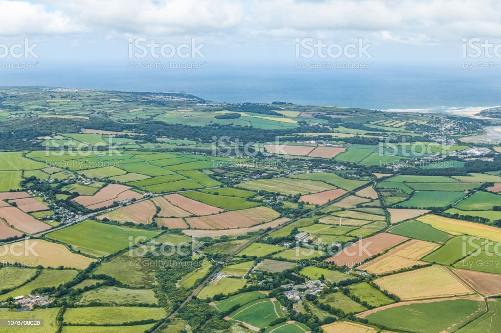 Aerial views over West Cornwall countryside on a sunny June day. stock photo