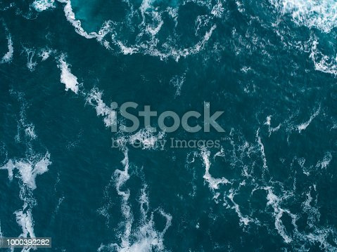 Close up photograph of a wave captured from a drone.