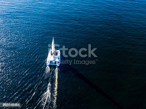 1066331604 istock photo aerial white travel cruise yacht isolated on blue sea still water 993448464