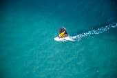 -brand clean- aerial wind surfer on action on blue waters