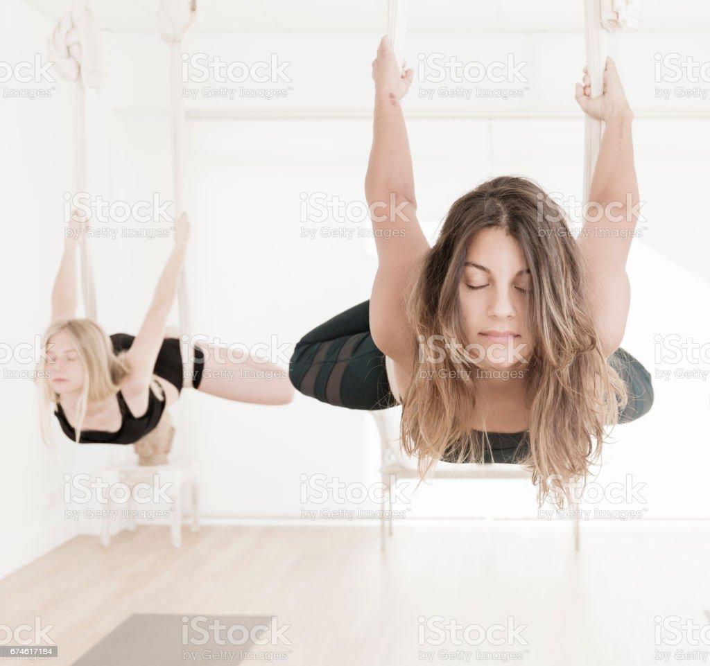 Aerial Yoga class stock photo